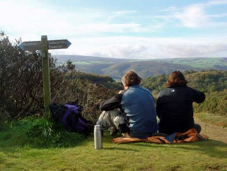 two walkers sitting next to a signpost
